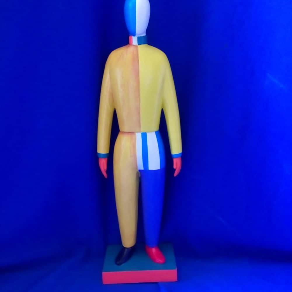 בובה בסגנון מלביץ מעץ צהוב כחול